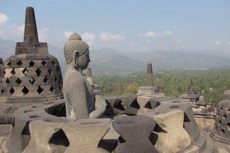 Buddha statue in stupa, Borobudur