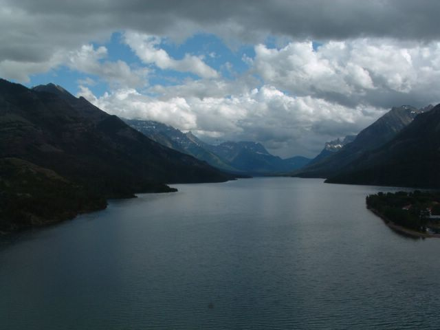 view of large lake, mountains and clouds